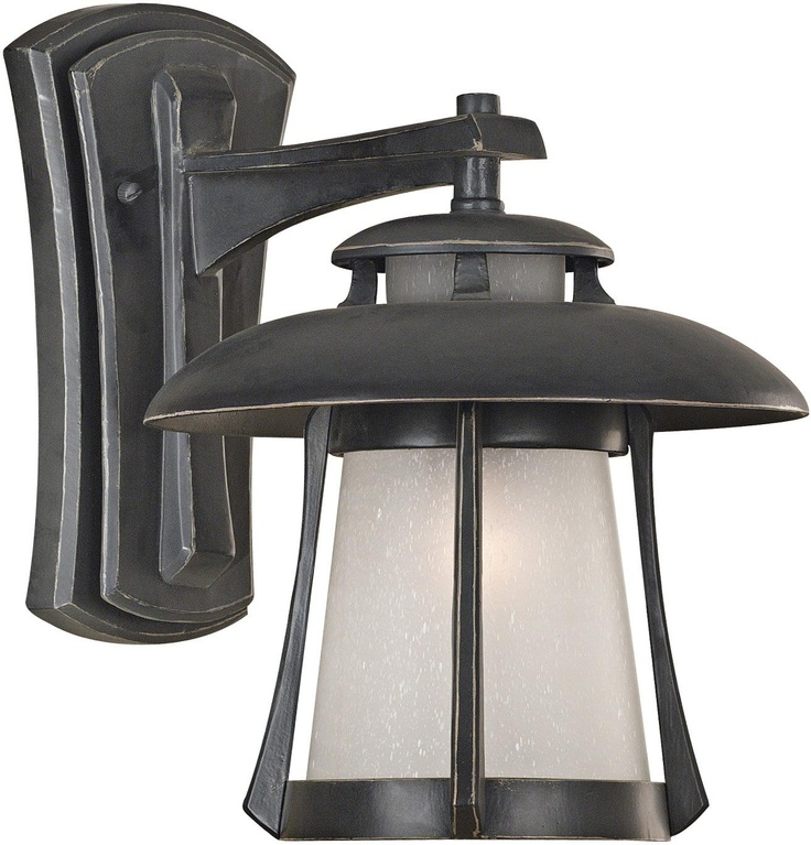 "Laguna Collection Ebony Pearl 13"" High Outdoor Wall Light $160.91   Compare $244.99    Wonderfully proportioned, this transitional wall light can fit with either a traditional or modern décor. It features an ebony pearl finish and frosted, seeded glass. This bold, clean design from Hunter Lighting is a great way to brighten the exterior of your home.    Ebony pearl finish.  Frosted, seeded glass.  Takes one 100 watt bulb (not included).  13"" high.  10"" wide.  Extends 13"" from the wall."