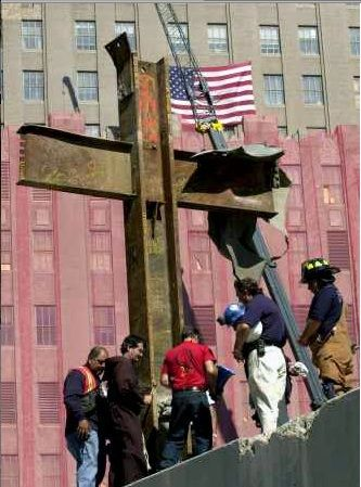 "cross at ground zero || Remember that cross was part of one of two tall buildings until they became intimately acquainted with the Islamic religion, and thousands of people were ""sacrificed."""