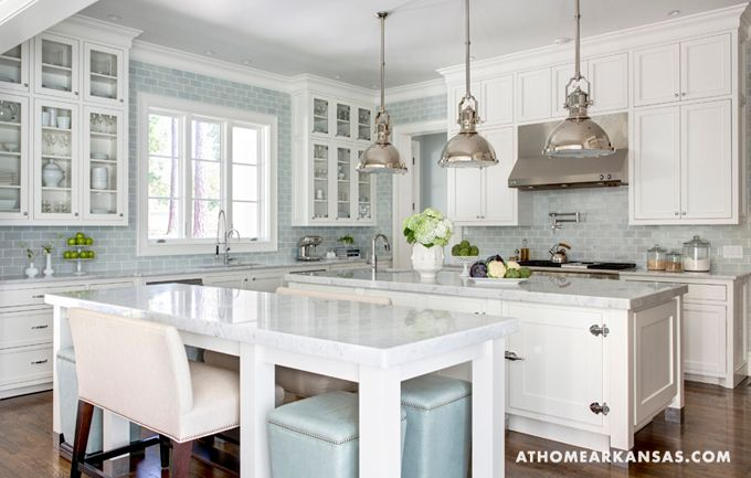 Traditional kitchen with blue subway wall tile, antique nickel light fixtures, double islands, marble tops, walnut floors. Love the cabinetry all the way to the ceiling. design by  Melissa Haynes of MH Design out of Rogers, Arkansas and photographed by Rett Peek for At Home in Arkansas