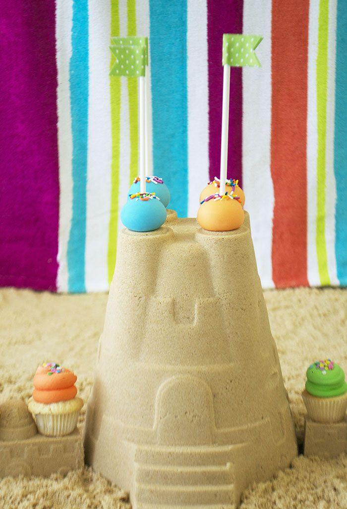 Festive Cake Pops on a brown sugar sand castle. By Bake Sale Toronto.