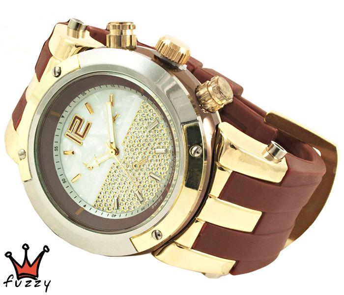 Γυναικείο ρολόι, με κάσα σε χρυσό και ασημί με ιδαίτερο εσωτερικό καντράν, στολισμένο με στρας.  Λουράκι σε καφέ χρώμα από σιλικόνη. Διάμετρος καντράν 44 mm
