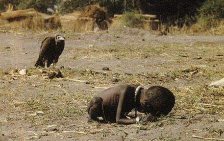 The photo is the Pulitzer prize winning photo taken in 1994 during Sudan famine. The picture depicts a famine stricken child crawling towards a United Nations food camp, located a kilometer away. The vulture is waiting for the child to die so that it can eat it. This picture shocked the whole world. No one knows what happened to the child, including the photographer Kevin Carter who left the place as soon as the photograph was taken. Three months later he committed suicide due to depression.