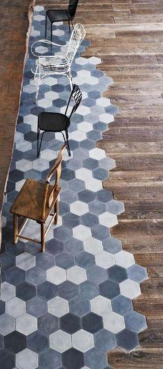 This floor. wow. Hexagon tiles meeting wood floor. Good way to break up a room without needing walls.