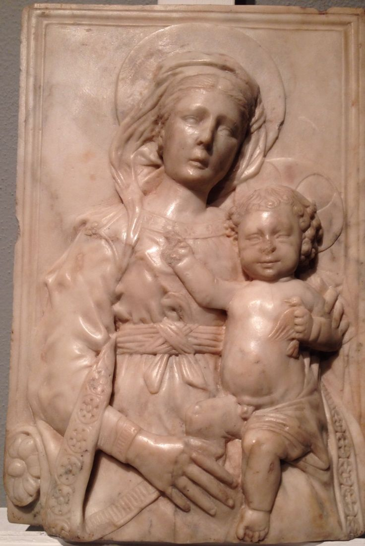 GREGORIO DI LORENZO (Florence 1436 - Forli' 1504)  Madonna with blessing Child, 1480 / 90 ca.  Marble bas-relief, 9x14x3 inches