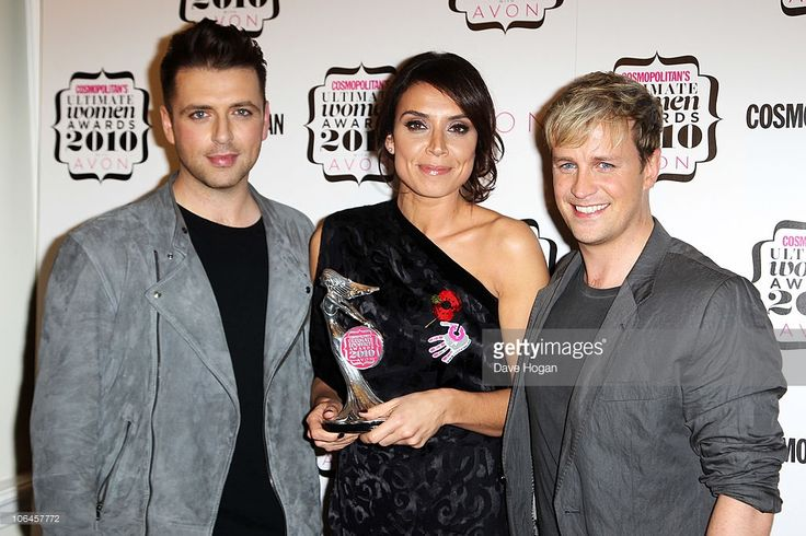 Mark Feehily and Kian Egan of Westlife pose after presenting Christine Bleakley with her Best TV Presenter award in the press room at the Cosmopolitan Ultimate Women of the Year awards 2010 held at Banqueting House on November 2, 2010 in London, England.