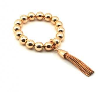 the simple life tassle bracelet by Adorne: rose gold