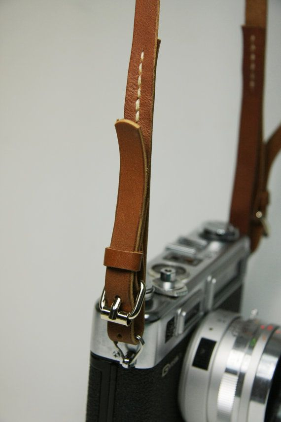 Simple Leather Camera Strap. This would be great.
