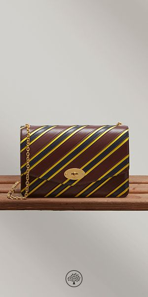 Shop the Darley, a classic clutch with iconic detailing - a combination found in the Darley with its namesake lock closure, elegant detachable chain strap and organised interior in nappa lining. For the Summer '17 collection, Johnny Coca revisits the Darley with college stripe variations in colours characteristic of British school uniforms.