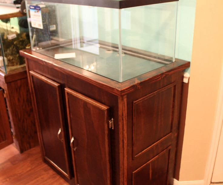 This aquarium stand was designed for a 40 gallon breeder tank on top, with a hidden side door to allow a 20 gallon long tank to be placed inside for ...