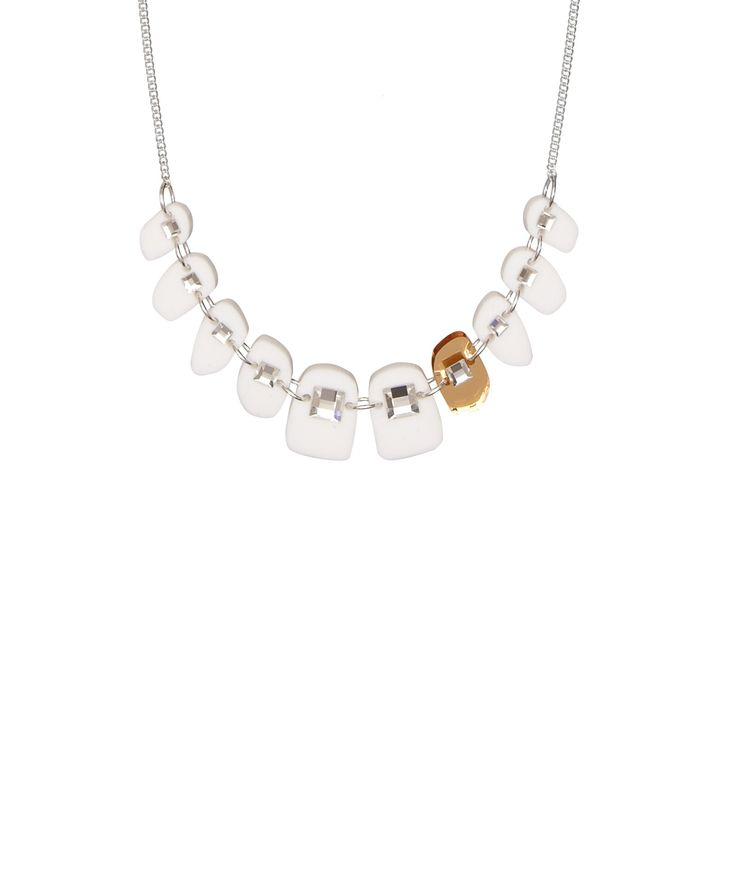 Dental Bling Teeth Necklace - Brace yourself for a new look with the Dental Bling Teeth Necklace. A row of pearly whites featuring a single gold mirror acrylic tooth are studded with Swarovski crystal braces. Orthodontics never looked so good.