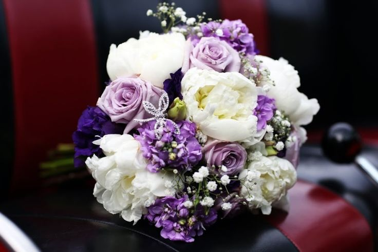 White peony and lavender rose bridal bouquet with rhinestone dragonfly pin from Seasonal Celebrations. Photo courtesy of Marielle Hayes Photography