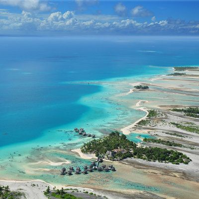 Tikehau Pearl Beach Resort Tikehau, French Polynesia water sky outdoor Nature Beach Ocean Coast landform geographical feature body of water Sea shore blue bay islet cape wind wave archipelago caribbean Lagoon cove Island terrain reef clear swimming sandy overlooking