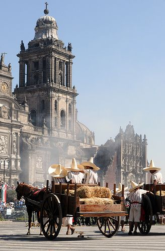 Mexican Revolution Day Parade in front of Metropolitana Cathedral in Zócalo square, the heart of Mexico City.