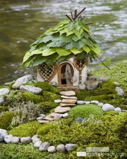 Fairy Garden with Stone Path. You can use silk leaves on the roof that will last a little longer than real ones, but real ones will continue aging and that looks neat too. The little girl in me still finds this delightful!