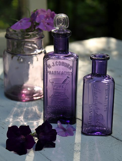 Apothecary bottles in purple. Never see these at the antique stores.