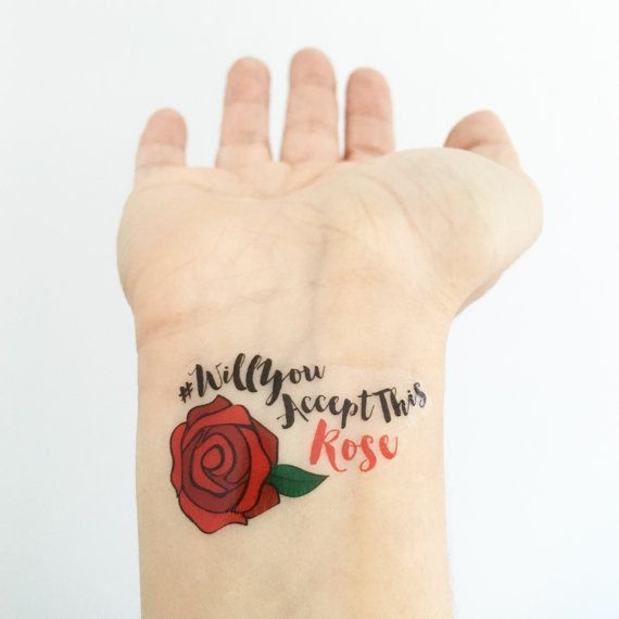 """** Please read instructions before ordering ** The greatest guilty pleasure of our time, are we right? You'll receive 15 tattoos that say #willyouacceptthisrose from ABC's The Bachelor / The Bachelorette, perfect for your viewing parties. Packaged up super cute with a little sponge, so you can apply easily at your party! * We are NOT able to do PARTIAL ORDERS. * Tattoos are approximately 1.6"""" Please read our shop policies before purchasing your order. By purchasing an item from our shop,..."""