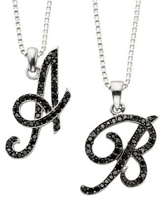 To the letter. Black diamonds (1/4 ct. t.w.) enliven these chic initial pendants—stunning on their own or layered with other chains for a luxe look.