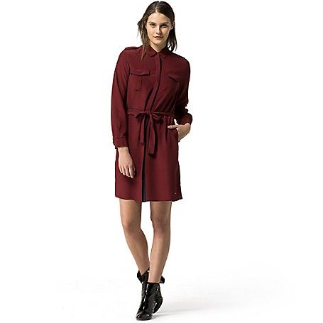 Tommy Hilfiger women's dress. This long sleeve cotton viscose dress is detailed with a pointed collar and contrast trim. Box pleats at the chest and self belt have a slimming effect, while the shoulder epaulettes give a utility edge. <br>• Classic fit.<br>• 100% rayon.<br>• Covered button placket. <br>• Machine washable.<br>• Imported.<br>