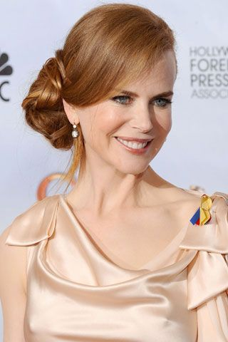 Nicole Kidman, Golden Globes 2010   A very romantic twist on the traditional up 'do shape, Nicole Kidman's pretty side-swept bun would be a good match for asymmetric dresses (wear the bun on the opposing side), or take the look with you if you're having a beachside wedding overseas.Updo Hairstyle, Bun Hairstyles, Nicole Kidman, Buns Hairstyles, Beautiful, Asymmetrical Hairstyles, Hair Style, Celebrities Wedding Hairstyles, Hairstyles Buns
