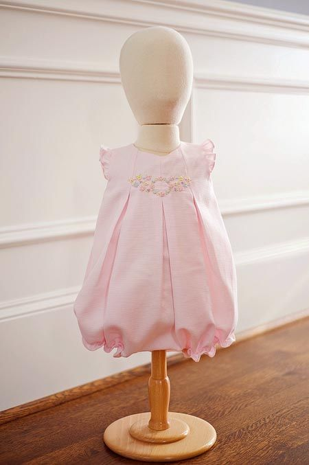 Baby Bespoke by Kathryn Beach specializes in clean, unfussy looks with timeless touches such as French knot embroidery. Two favorites from her Spring/Summer 2012 line, are the Amy Davis Bubble, in pale pink waffle pique with a delicate spray of embroidery at the neckline. For boys, buyers respond to Patrick, a poly-cotton overall, (that can be monogrammed), with coordinating button-down collared shirt. (Items fit sizes 3 to 12 months.) www.babybespoke.com