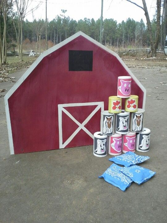 Farm theme Bean bag toss. For AJ's b-day party. Easy made from items around the house. Spray paint cans, cut out animal faces drawn on Microsoft paint, and a plywood cut out of a barn. Old bandana cut an sewn for the bags.