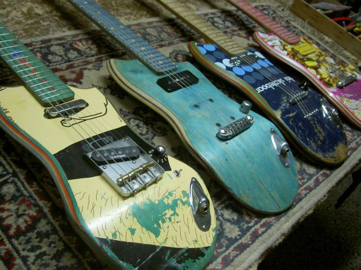 old skateboard decks transformed into electric guitars