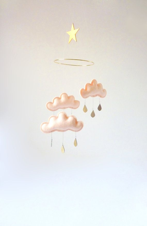"Puffy fluffy felt clouds on a 6"" gold ring. A very unique rainstorm! It hangs from a fine fishing line cord...so lovely!"