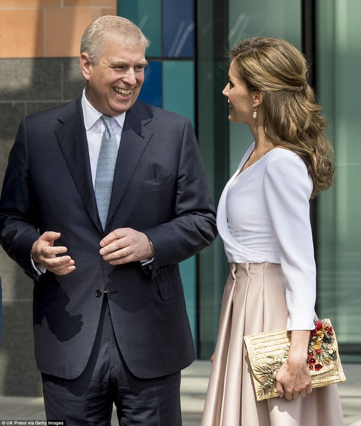 The Duke shared a joke with Letizia outside the research centre before heading inside. Onc...