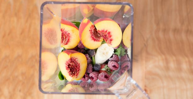 This non-green smoothie (with greens) tastes just like one you could purchase at a smoothie shop without the hefty price tag. #peach #berry #yum