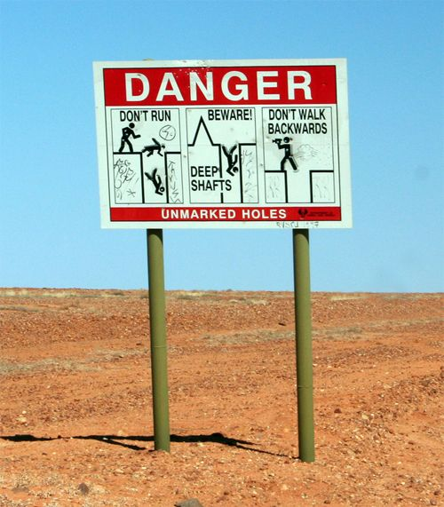Don't Walk Backwards ~ Sign at Coober Pedy, Oz.