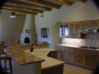 """HowStuffWorks """"Benefits of Rammed Earth Construction""""- a look at a kitchen in a rammed earth home."""