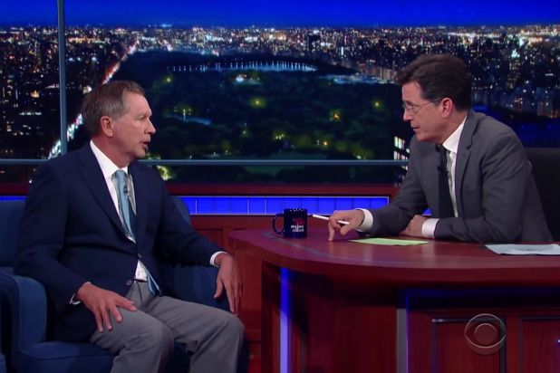 """""""Late Show"""" host Stephen Colbert took Republican presidential contender John Kasich to task Friday night over the Ohio governor's opposition to legalizing marijuana, greeting him with a series of serious questions on the subject."""