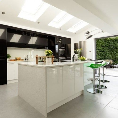 If you're considering a kitchen extension, a pitched roof with sky lights will allow in plenty of light, while double doors will offer a view of the garden beyond.