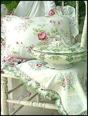 how pretty, love the pillow colors, the hand stitched doily and the what looks like a soup tureen? Such a pretty display