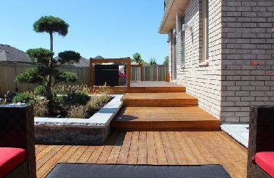Wood deck, stone retaining walls, modular patio furniture. Modern landscape design. Completed by Leaf Garden Design Inc.  | westview