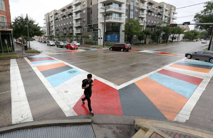 A pedestrian crosses at a new artistic crosswalk at the intersection of Elgin Street and Louisiana Street on Tuesday. Photo: Jon Shapley, Staff / © 2015 Houston Chronicle