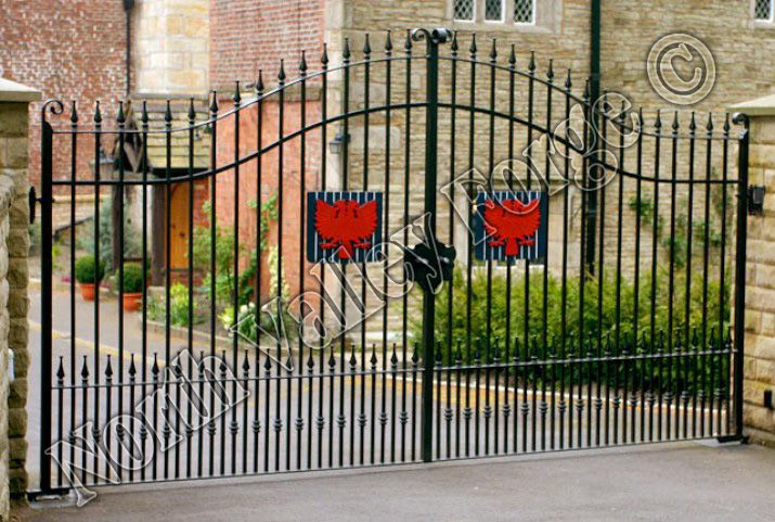 Wrought iron estate gates with beautiful flower emblem