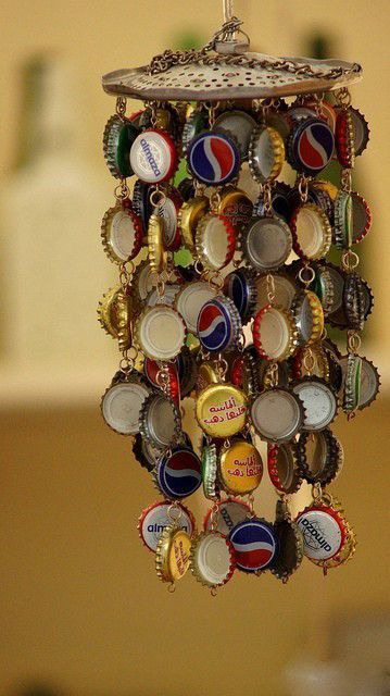 Bottle cap wind chime-I like the idea, but this one seems junkyard-ish. I think I could add some beads or sea glass, and use a different top.