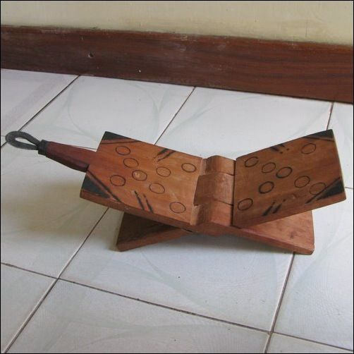 Tanzanians : The Coconut Grater Is A Foldable Stool With A Grating Hook On  One End