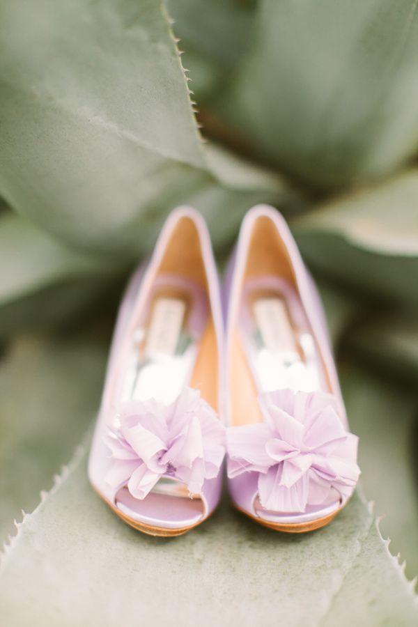purple wedding shoes, photo by J.Bird Photography http://ruffledblog.com/austin-le-san-michele-wedding #weddingshoes #badgleymiscka