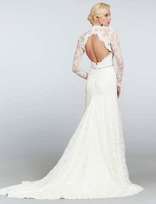 This dress has a detachable bolero jacket over a strapless low back dress giving you a keyhole open back for 1 look remove the jacket for a strapless bridal gown