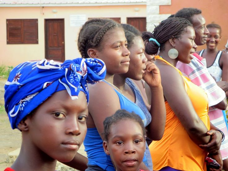 Local residents gather to watch traditional dancing outside the Igreja de Pantufo on Sao Tome Island, São Tomé and Príncipe.