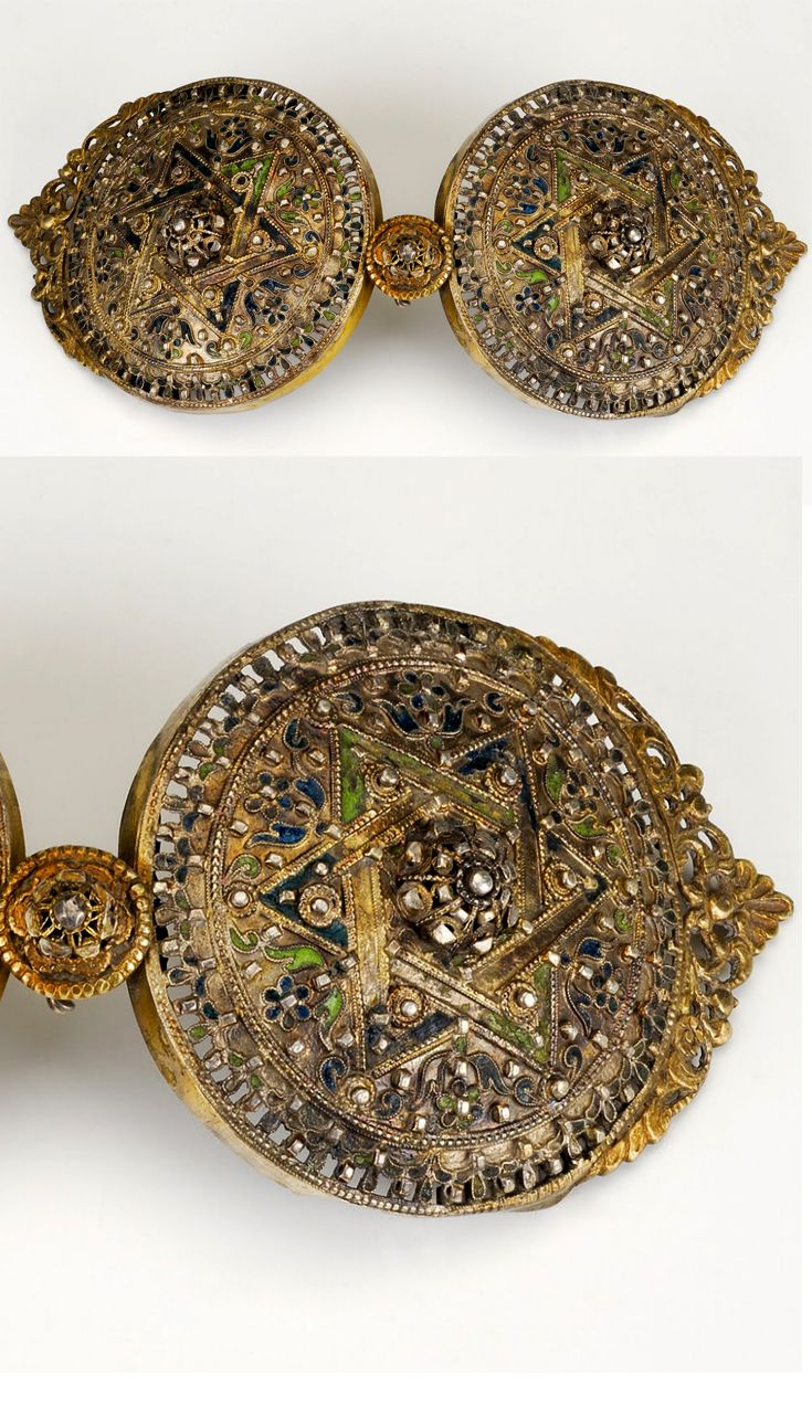 Women's belt buckle decorated with a floral design in filigree enamel and six pointed star. Late-Ottoman, ca. 1800-1850.  The six-pointed star ('Davut Yıldızı' = Star of David) was used by Muslims and Christians.   This jewel was brought to Greece as a heirloom by refugees from Anatolia (possibly from the Konya region).