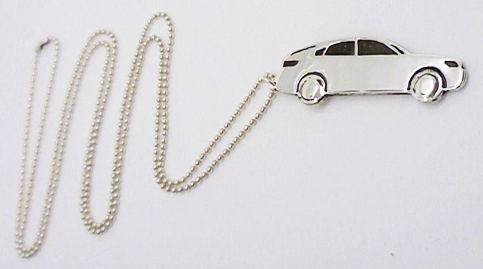 Race Car Necklace - Sterling Silver http://www.hilaryandjune.com/product/sterling-silver-race-car-pendant-necklace