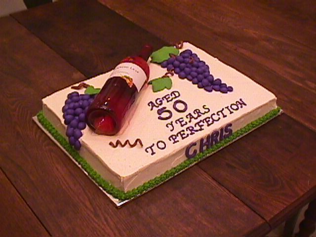Wine Bottle - A co-worker asked me to make a cake for her SIL who was turning 40.  Yes, I messed up and put 50 on the cake instead of 40.  I was pretty embarassed when she came to pick it up and I had to do a quick correction!  Anyway, grapes and vines are fondant, wine bottle is real.