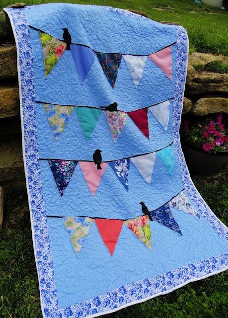 I'd like to do this with bits of my mother's clothes I saved. Love the pattern, but may incorporate hummingbirds instead - Oxford Impressions: Patti's Memory Banner Quilt With Bird Appliques