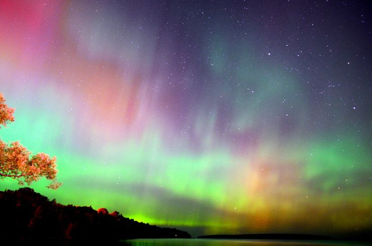 Aurora Borealis in Bayfield, Wisconsin on the south shore of Lake Superior ~ by Katrina Werchouski