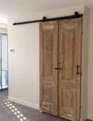 Oude kastdeuren als Loftdeur