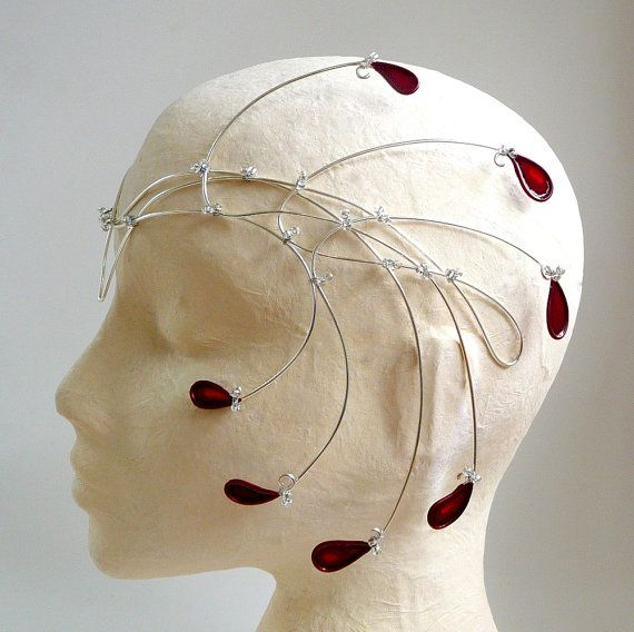 This is so beautiful! I want it so much! Silver and deep red circlet, handmade. $95.00, via Etsy.