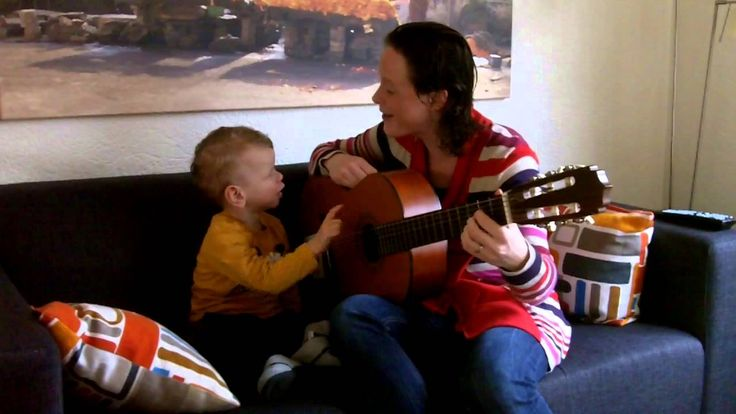 Arje (3, Williams Syndrome) plays guitar